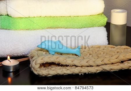 Towel Pile With Bast And Dolphin Form Soap.