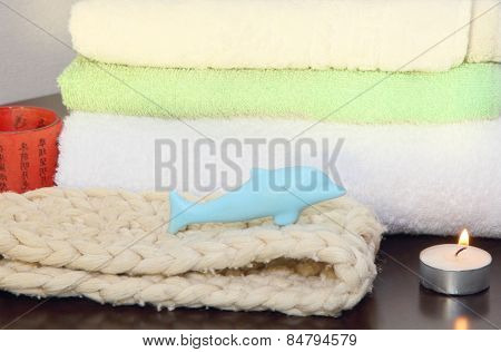 Towel Pile With Bast And Dolphin Form Soap In The Shower.