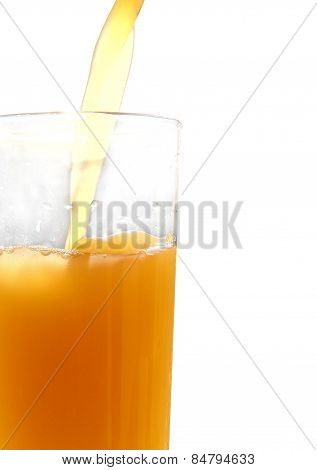 Orange Juice Pouring In Glass On White Background.