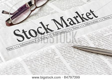 A Newspaper With The Headline Stock Market