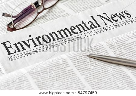 A Newspaper With The Headline Environmental News