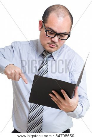 Serious Businessman point out something from report