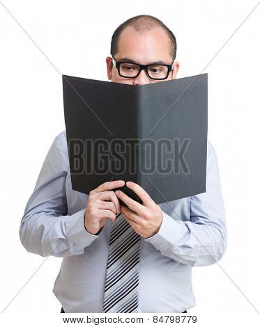 Serious businessman read on the report