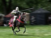 image of jousting  - Armored rider with lance on horse - JPG