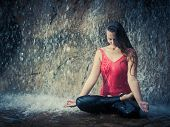 picture of padmasana  - Woman practicing yoga near waterfall - JPG