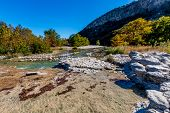 stock photo of crystal clear  - Rocky River Bed of the Crystal Clear Frio River - JPG