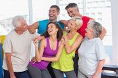 image of senior class  - Happy playful friends looking at senior man at fitness studio - JPG