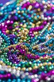 image of carnivale  - A background of mardi gras beads with copy space - JPG