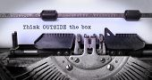 stock photo of old vintage typewriter  - Vintage inscription made by old typewriter think outside the box - JPG