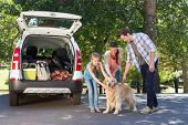 pic of road trip  - Family getting ready to go on road trip on a sunny day - JPG