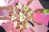 foto of  breasts  - Smiling women organising event for breast cancer awareness on a sunny day - JPG