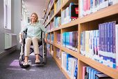 pic of disability  - Smiling disabled student in library at the university - JPG