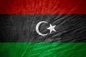 picture of libya  - Libya flag or Libyan banner on wooden texture - JPG