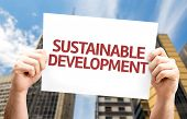 image of sustainable development  - Sustainable Development card with urban background - JPG