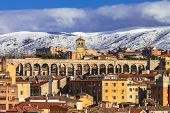 stock photo of aqueduct  - view of Segovia with roma aqueduct and mountains - JPG