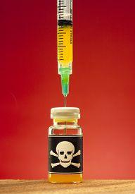 stock photo of toxic substance  - poison and plastic syringe - JPG