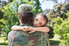 picture of reunited  - Soldier reunited with his daughter on a sunny day - JPG