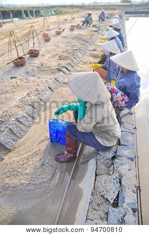 Ninh Hoa, Vietnam - March 2, 2012: Vietnamese Women Salt Workers Are Relaxing After Working Hard To