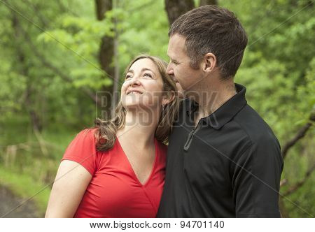 couple standing on forest trail