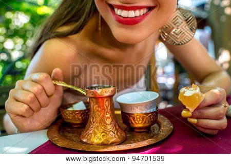 Woman with turkish coffee