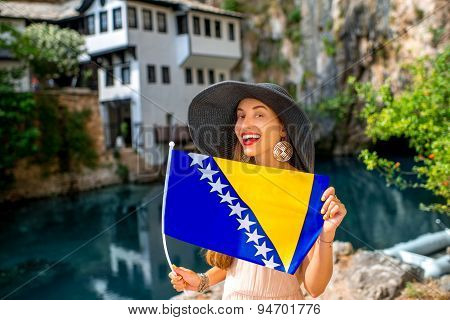 Woman with Bosnian flag in Blagaj village