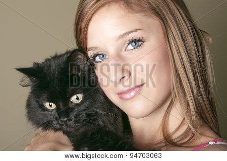 Young happy woman with is black cat