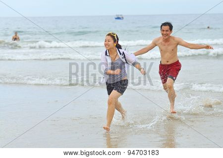 Nha Trang, Vietnam - July 30, 2011: People Are Playing In The Nha Trang Beach, One Of The Most Beaut