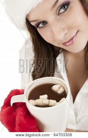 Young woman in winter hat with cup of hot chocolate