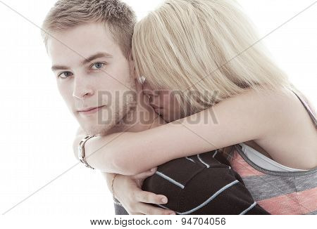 happy young loving couple embracing, white background