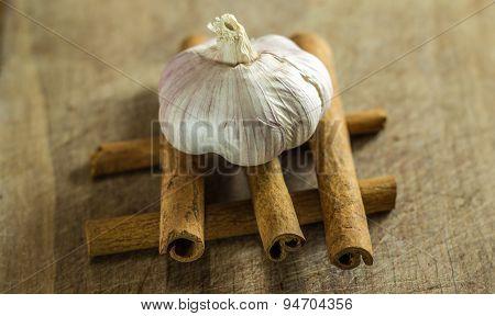 Garlic on top of Cinnamon Sticks