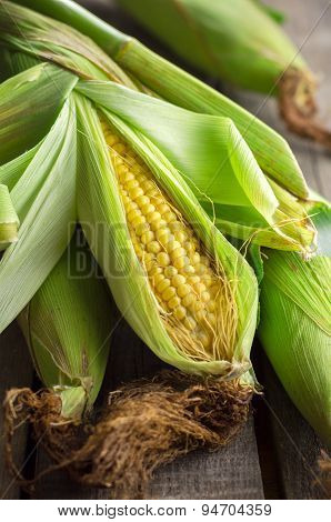 Golden fresh corn on wooden table