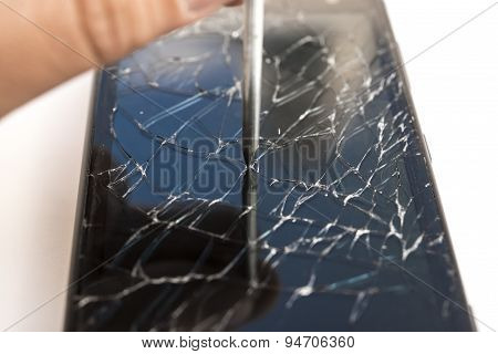 Nail Hits The Lcd Of A Broken Smart Phone