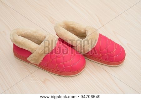 Pair Of Pink Shoes For Lady On Wood