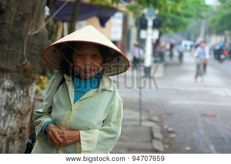 Nam Dinh, Vietnam - March 30, 2010: An Old Woman Is Walking On The Pavement To Her Home In Nam Dinh