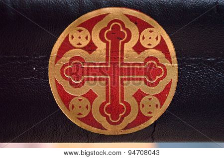 Gold And Red Cross In Circle On Leather