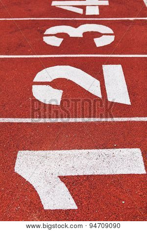 Red running path with white lines numbers flat view