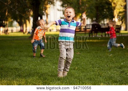 Group Of Kids Playing In Urban Neighborhood