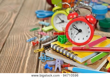 Red Alarm Clock And Colorful School Supplies