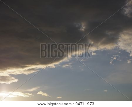 cloudy sky and sunbeams