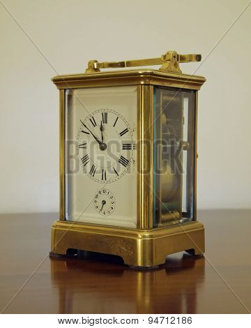 old bronze clock minutes to twelve