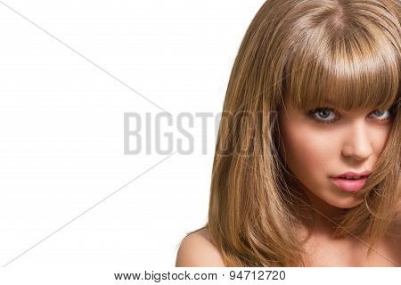 Portrait of a beautiful young blonde woman on a white background