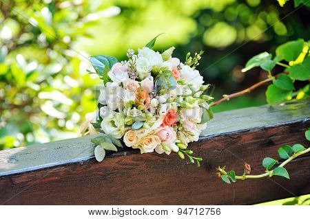 Wedding Bouquet On The Wooden Beam