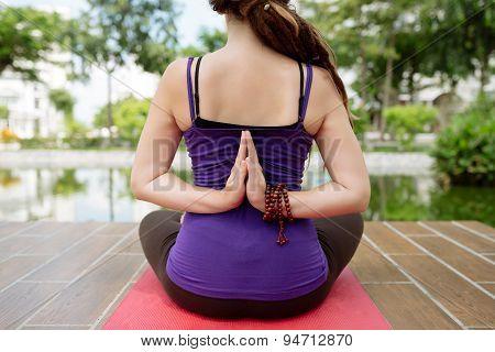 Performing lotus pose