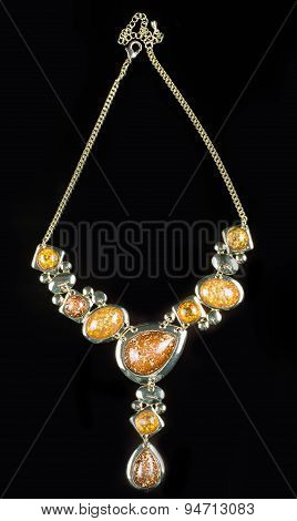 luxury yellow necklace on black stand