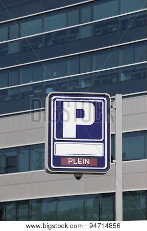 Parking Signpost With Plein Text And Modern Building Background
