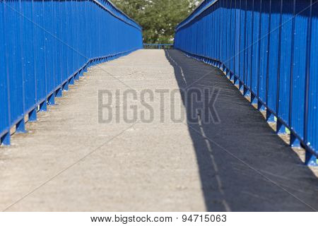 Concrete Pedestrian Bridge In Blue Tone And Tree