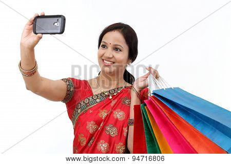 Traditional Indian Woman With Shopping Bags And Take Selfie