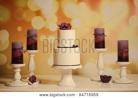 White Cake With Purple Candles