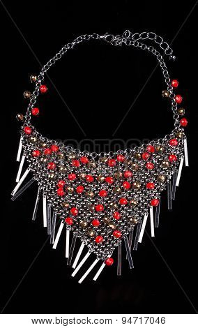 luxury red necklace on black stand