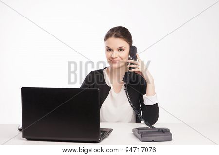 Young woman with  laptop talking on the phone
